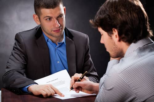 investment fraud attorney talks with client
