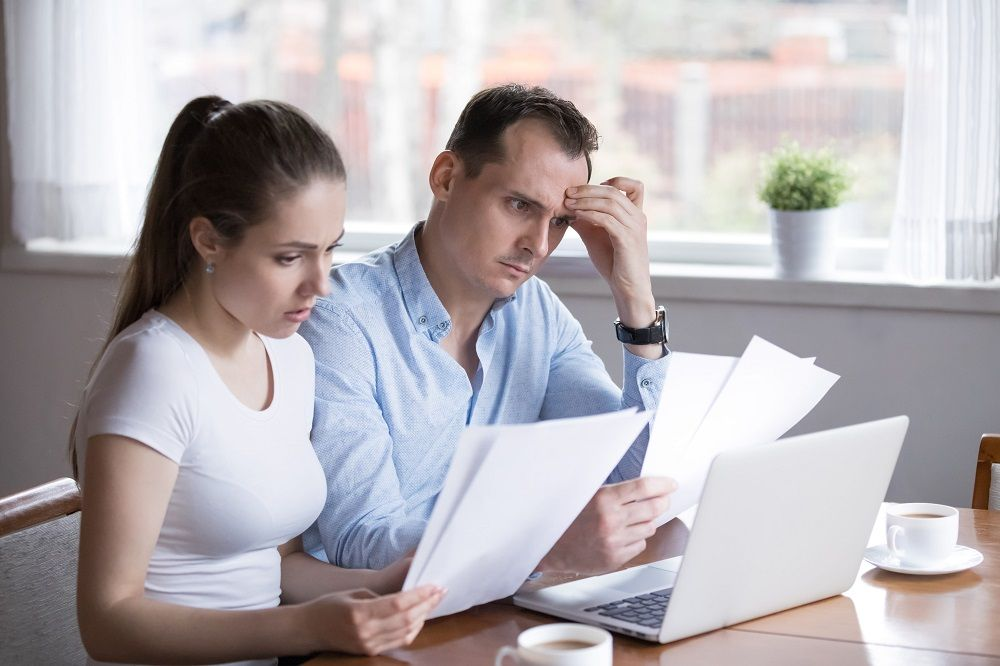 Problematic couple thinking on their investment contract.